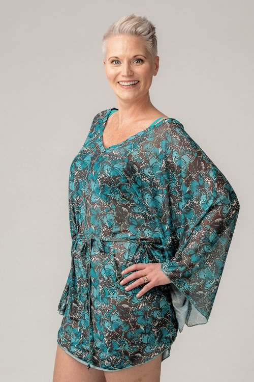 Turquoise butterfly pattern beach poncho for ladies from Sunkini.